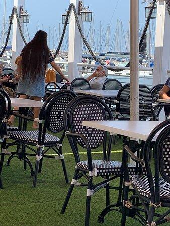 Seven photos of people enjoying the marina.