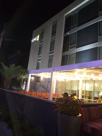 The Exterior of the Hotel at Night, and the outside Front Patio Seating is big and can seat a lot of people.