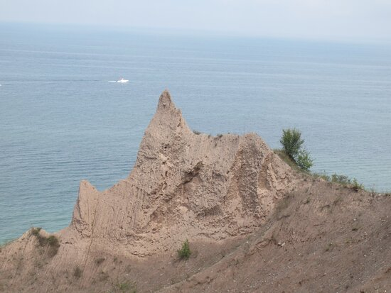 Bluffs with boat in the background.