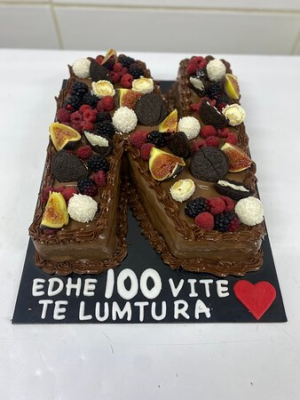 Chocolate cake (chocolate mousse) with chocolate and fruit on top