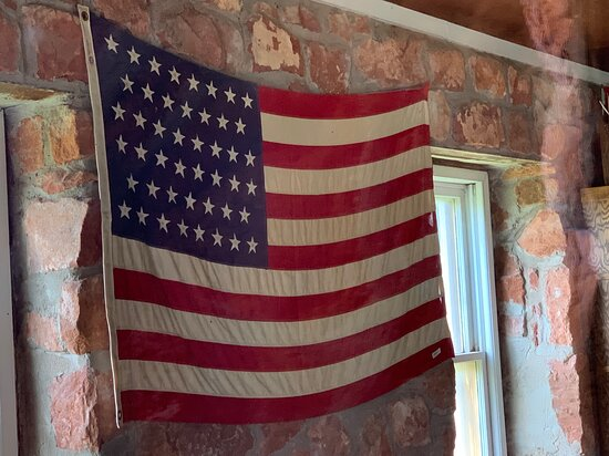 flag inside the schoolhouse (count the stars to know the year)