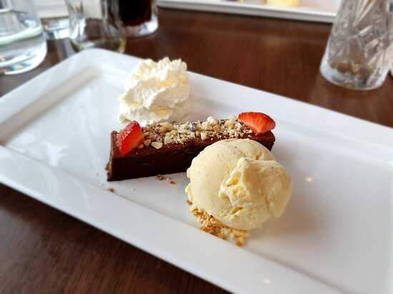 A rich chocolate cake to finish with cream and ice cream and a fitting end to a great meal