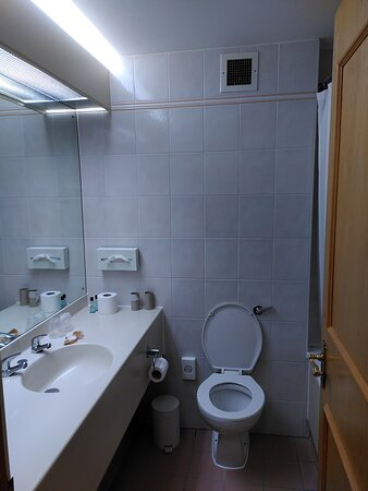 The en-suite was in desperate need of a working extractor fan and an entire overhaul- mismatching tiles.