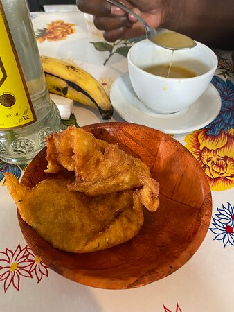 Today my husband and I asked a young man where could we get some authentic Puerto Rican food and he suggested this place. When I tell you I wasn't disappointed , food was outstanding. I don't know the name of what I ate but I do know that it was steak, onions, rice and beans with sweet plantains on the side. My husband had what I had but instead of steak he had pork chops. I was nervous about area but they do have parking. I ubered. They do close at 4:00