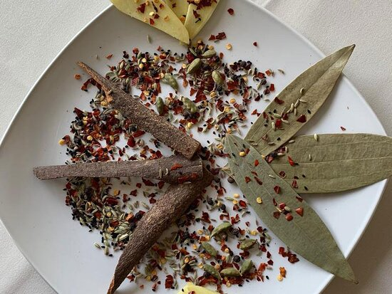 Plate of raw spices used in curries