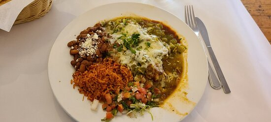 Traditional chiles rellenos with green salsa