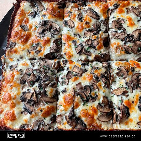 Fun Guy Detroit-style Pizza. Tomato sauce base, shredded mozzarella, loaded with cremini and porabello mushrooms, finished with fresh parmesan, a sprinkle of oregano and black truffle sea salt.