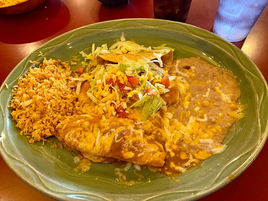 Tasty combo: pork tamale, chicken enchilada, ground beef taco, plus rice and creamy beans.