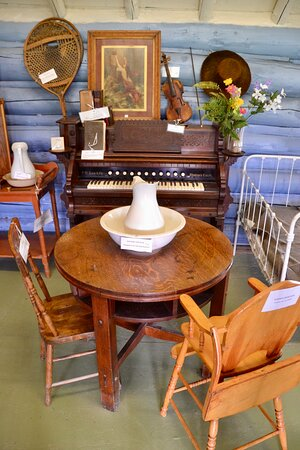 Piano and table in cabin