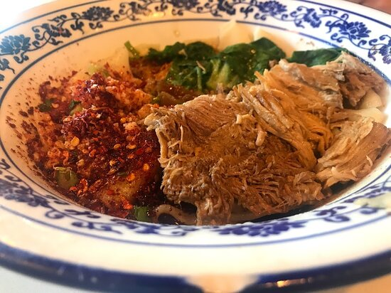Spicy hot oil stewed pork with hand-made noodles ($12.49)