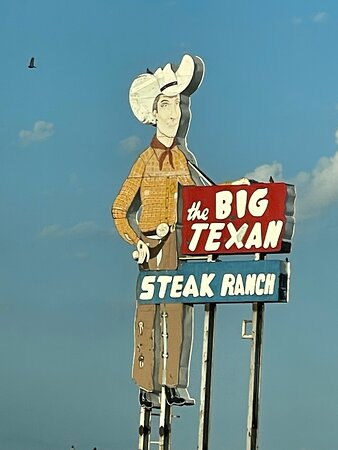 Hotel is located on the east side of the Big Texan restaurant.