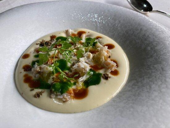 Crema di patata, granceola, bisque e oyster sauce.