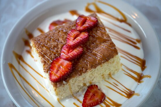 Chuy's famous Tres Leches cake! Drizzled with caramel and topped with fresh strawberries.