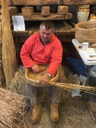 Robbie Ryder showcasing the endangered skill of straw skep weaving.