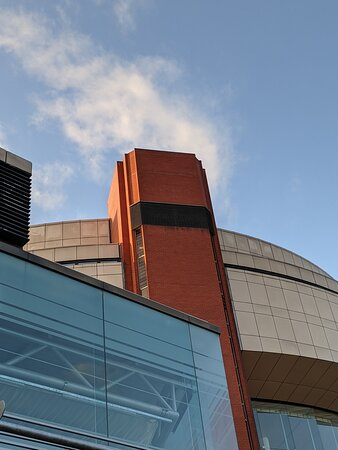 The ambitious brick-brutalist work towers above the sleepy town now with a patina of soot on the ceramic cream elements. Best understood in black and white. Also it seems scaled-down all the same... Launched with the Eurovision Song Contest in 1982, it appears it was soon inadequate a complex and a boring extended exhibition hall section in post modern classic was added what 20 odd years later maybe.