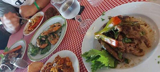 Some delicious grilled shrimp and Sea food Spaghetti.