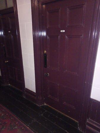 Dark corridors; exposed floors, dark doors