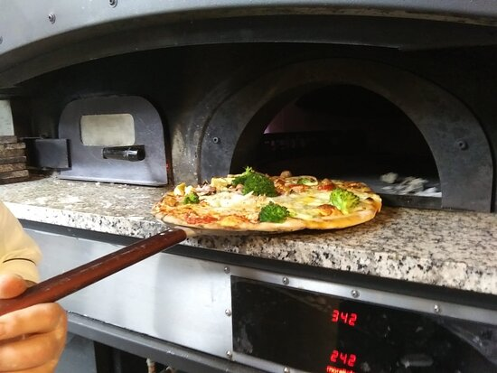 Italian restaurant , fired wood specialities, fired wood pizza
