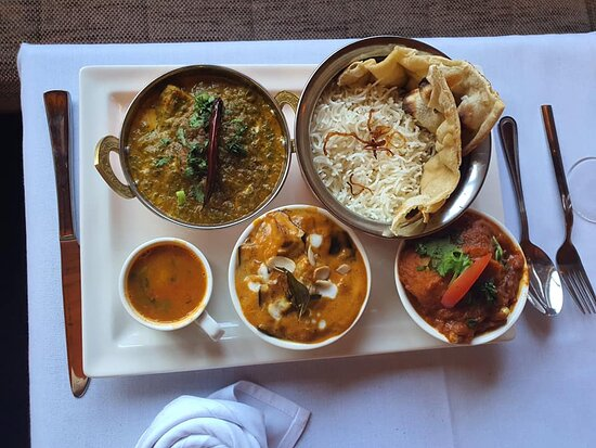 Thali with dal tadka, butter chicken and organ josh
