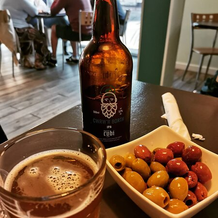 Local beer & yummy olives while we waited for pinse to arrive