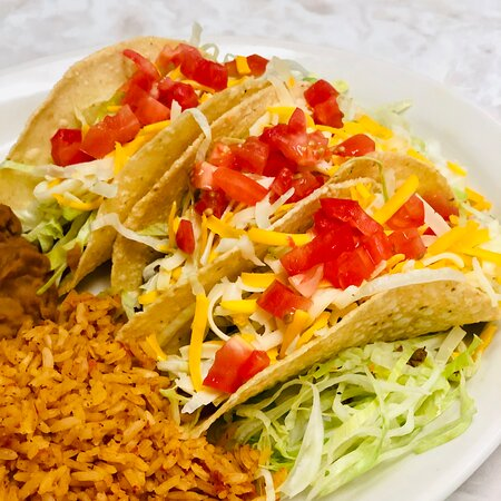 Crispy Tacos - hand-formed corn tortillas filled with seasoned ground sirloin, cheese, lettuce, and tomatoes.
