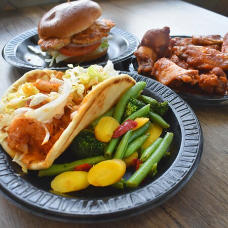 Grilled Shrimp Gyro, Grilled Chicken Sandwich, Buffalo Wings, and Steamed Veggies
