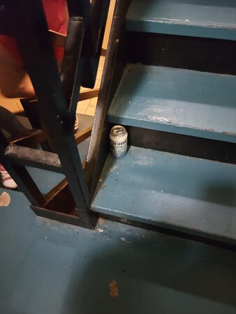 Beer cans littered the stairs