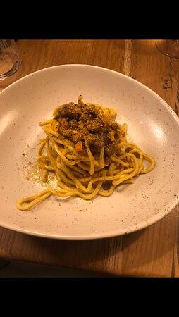 Chitarra style spaghetti with knife-cut duck ragù and orange sauce