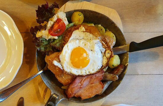 Haus Topf with fried egg on top. This was a pork dish of various types with skillet potatoes.