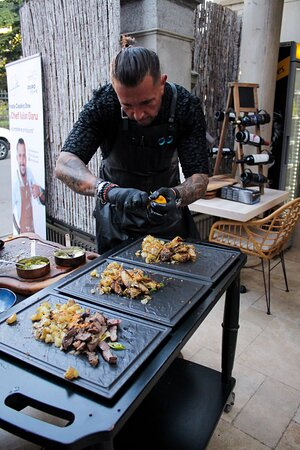 Chef Iulian plating on cooking show