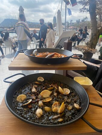 Black rices Paella with squid