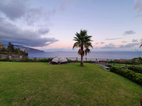 Les Suites Hotel grounds and mini cabanas looking out to the Funchal bay.