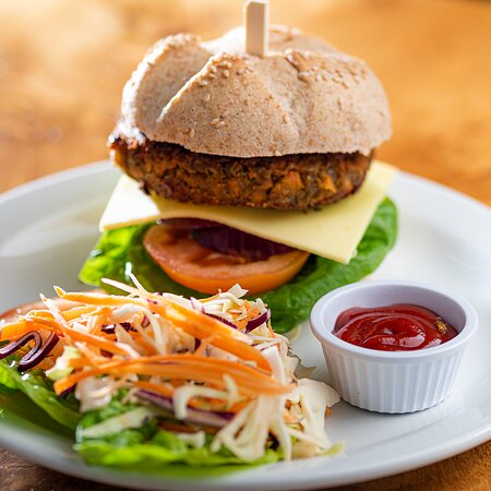 Look at this biiiig vegan Sweet Potato Burger! It is served on a Findhorn Bakery Roll with vegan cheese, salad, organic Ketchup and garnish.