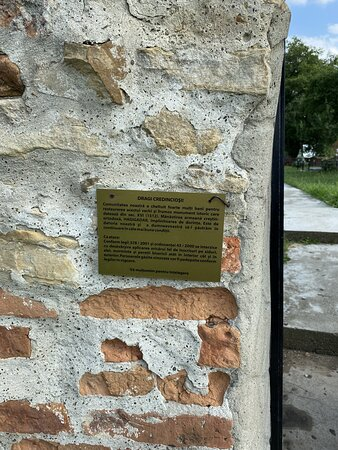 """A very small plaque , as you enter from the """"hill side""""."""