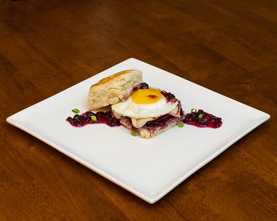 Biscuits and Gravy - Buttermilk Biscuits, Prosciutto, Brie, Egg, and Plum Chutney.