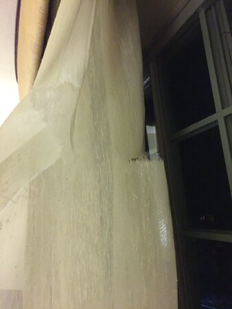 Curtain liner with two torn areas