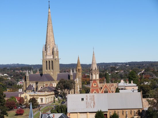 The cathedral from the Poppet Head on Camp Hill in Rosalind Park. It towers over the spire of the neighbouring red brick Presbytarian Church.