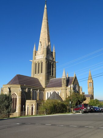 The cathedral on the corner of Mackenzie Street and Short Street. Dominant central spire. North transept to the right and the eastern end of the nave/altar to the left of the spire.
