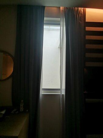 Window facing wall
