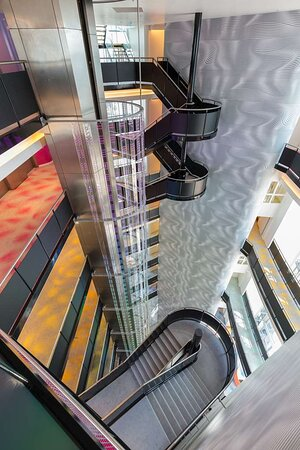 Colorful Guest Floors w Panoramic Elevator