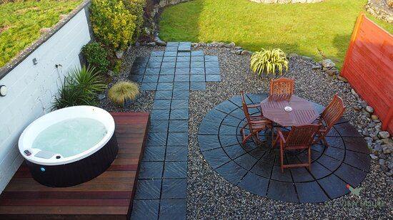 Terrace with hot tub and dining area at our Fisherstreet Lodge