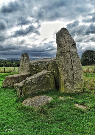 The two flanking stones, either side the recumbent stone, which are grey granite