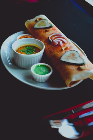 Masala Dosa - Did you know our Dosa on the wall charity initiative offers free Masala Dosa to anyone in need of a meal !