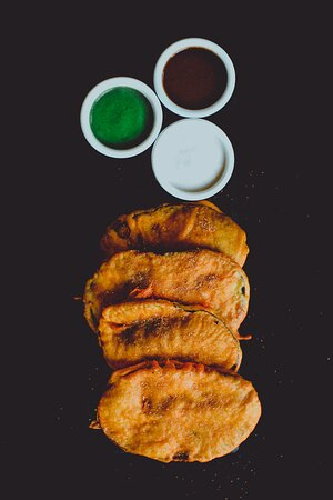 Aubergine Pakora - How we miss this one but had to keep it our with the sheer size of our menu! However, if you are a fan do write us to bring it back. Now, we can't turn that down :)