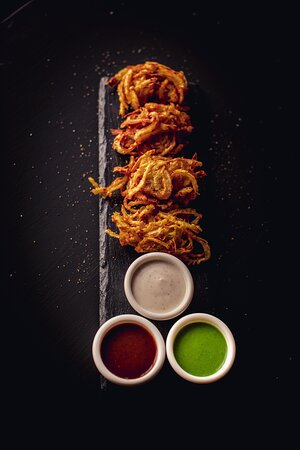 Onion Bhaji's - Crispy outside and softie inside. No matter your drink or main food, this is a perfect start!