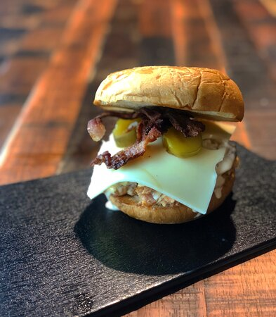 THE BAMA: SMOKED CHICKEN, ALABAMA WHITE BBQ SAUCE, WICKLE'S PICKLES, SWISS, BACON, COLESLAW