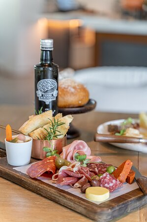 Our Charcuterie Board, a classic appetizer, where we only select the highest quality of meats for guests to indulge.