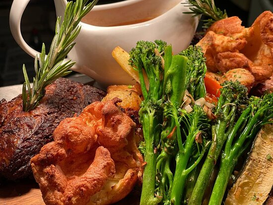 Sunday Roast - either a slow roasted pork knuckle or beef rib, served with all the traditional sides