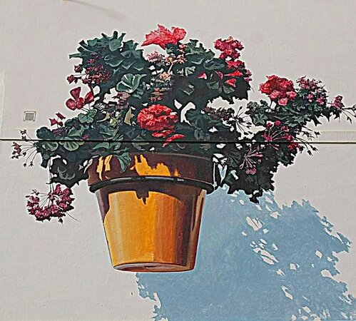 Real flowers in the garden, painted flowers in the surrounding murals!