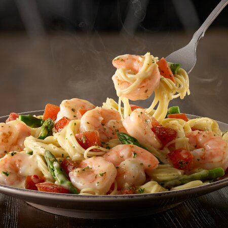 Shrimp sautéed in a garlic sauce, tossed with asparagus, tomatoes, and angel hair pasta.